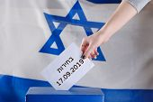 Israeli Woman Votes On Election Day. Close Up Of Handhebrew Text Elections 17.09.2019 On Israel Flag poster