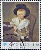 a stamp printed in the Norway shows portrait of a child with hat on commemorate the International
