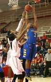 JAMAICA, NY-JAN 2: Delaware Blue Hens guard Jaquetta May (3) goes up for a shot against the St. John