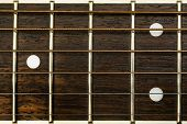 image of fret  - close up of a guitar neck couple of frets - JPG