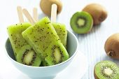 stock photo of popsicle  - Kiwi Ice Cream Popsicle with Lime - JPG