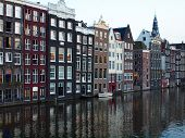 image of sabbatical  - Amsterdam canals and typical houses with clear summer sky - JPG