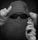 pic of incognito  - Incognito personification with cotton gloves glasses baseball cap and mobile phone