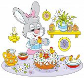 picture of fancy cake  - Easter rabbit decorating a fancy cake for the holiday table - JPG