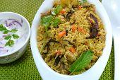 image of raita  - Vegetable biriyani served with raita - JPG