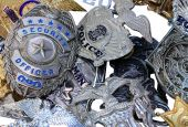 stock photo of bobbies  - A large group of police shields and badges randomly piled - JPG