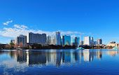 picture of skyscrapers  - Orlando Lake Eola in the morning with urban skyscrapers and clear blue sky - JPG