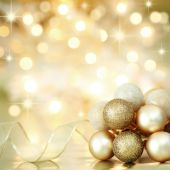 image of christmas party  - Gold Christmas baubles and ribbon on background of defocused golden lights - JPG