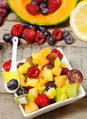 pic of greedy  - greedy fruit salad with and fruits background on wood table - JPG