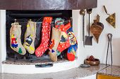 foto of epiphany  - Chimney with epiphany socks during christmas holidays - JPG
