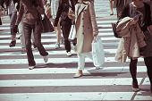 picture of pedestrian crossing  - Pedestrians cross at Shibuya Crossing in tokyo - JPG