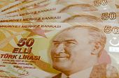 stock photo of turkish lira  - Turkish fifty Lira banknotes laid out in a fan with the face of Mustafa Kemal Ataturk engraved - JPG