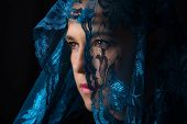 foto of hijabs  - Middle Eastern woman portrait looking sad with a blue hijab artistic conversion - JPG