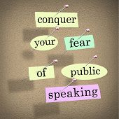 picture of public speaking  - Conquer your fear of public speaking words on papers pinned to a bulletin board - JPG