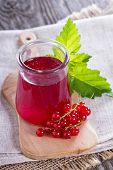 foto of jar jelly  - Red currant jelly in a jar with fresh berries