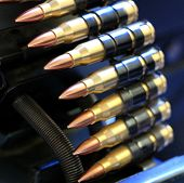 stock photo of m16  - A close up shot of a row of machine gun bullets with copper tips  - JPG