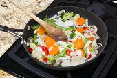 image of snow peas  - Fresh mixed vegetable stir fry with onions - JPG