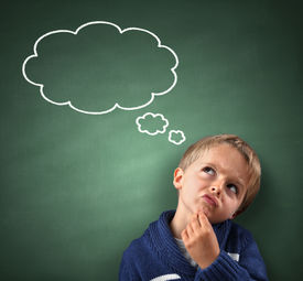 picture of confusing  - Child thinking with a thought bubble on the blackboard concept for confusion - JPG