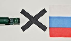 foto of truck-stop  - Truck and black in front of a Russian flag simbolize stop of food import to Russia - JPG