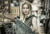 pic of boutique  - Beautiful blonde female looking jeans in the boutique - JPG