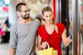 stock photo of mall  - Couple at shop window in mall shopping - JPG