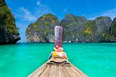 image of koh phi-phi  - Traditional wooden boat in a picture perfect tropical Maya bay on Koh Phi Phi Le Island - JPG
