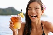 stock photo of waikiki  - Hawaii woman drinking Mai Tai hawaiian drink - JPG
