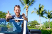 pic of road trip  - Car driver showing keys and thumbs up happy - JPG