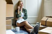 picture of independent woman  - Portrait of young beautiful woman moving in new home - JPG