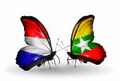 foto of holland flag  - Two butterflies with flags on wings as symbol of relations Holland and Myanmar - JPG