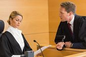 stock photo of court room  - Lawyer speaking with the judge in the court room - JPG