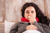 foto of sneezing  - Sick woman caught a cold - JPG