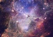 foto of nebula  - Far being shone nebula and star field against space - JPG