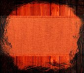 image of tangelo  - Closeup burlap textured background with black frame design - JPG