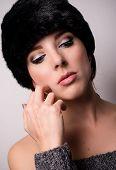 Thoughtful Pretty Woman Wearing Furry Bonnet poster