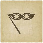 stock photo of masquerade mask  - Masquerade mask symbol old background  - JPG