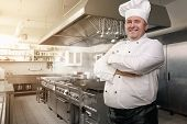 image of chef cap  - Portrait of a happy chef in the industrial kitchen with copy space - JPG
