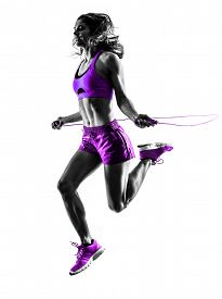 stock photo of roping  - one caucasian woman exercising  Jumping Rope fitness in studio silhouette isolated on white background - JPG