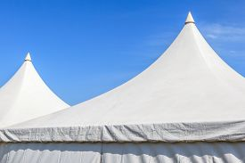 pic of canopy roof  - Top of white canvas tent with clear blue sky background for big event party - JPG