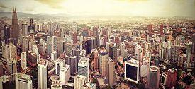 image of petronas towers  - Retro filtered skyline of Kuala Lumpur Malaysia - JPG