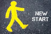 image of start over  - Yellow pedestrian figure on the road walking towards NEW START - JPG