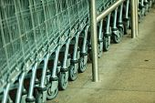stock photo of grocery cart  - Row of empty shopping cart trolley - JPG
