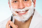 Постер, плакат: Handsome Man Shaving With Razor