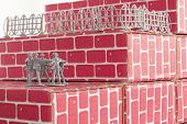 pic of underdog  - Gray toy army men up against impossible odds in uphill battle - JPG