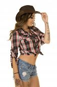 picture of cowgirl  - A cowgirl with her hand on her hat and her tattoo on her body - JPG