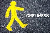 foto of loneliness  - Yellow pedestrian figure on the road walking towards LONELINESS - JPG