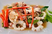 stock photo of squid  - stir fried hot and spicy squid with basil leaf on plate - JPG