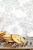 foto of chocolate-chip  - Chocolate chips cookies with loosely scattered chocolate chips over a rustic background - JPG