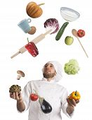 picture of juggling  - Playful chef likes to juggle while cooking - JPG
