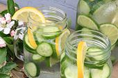 foto of cucumber  - In hot summer day on the table decorated with apple tree blooms in backyard is served Naturally Flavored  - JPG